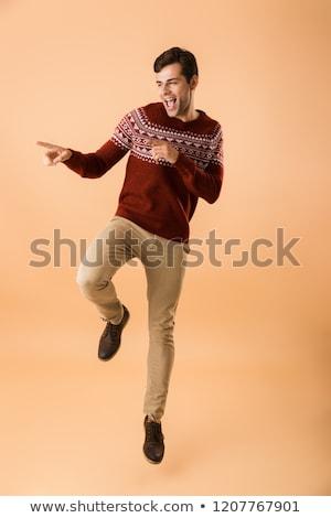 Immagine gioioso uomo 20s setola indossare Foto d'archivio © deandrobot