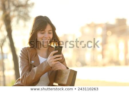 подростку · женщину · мобильного · телефона · лет · носить · платье - Сток-фото © deandrobot