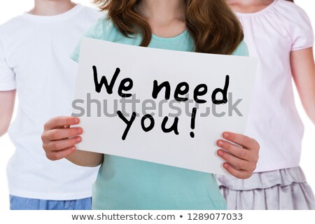 close up of a girl holding we need you placard stock photo © andreypopov