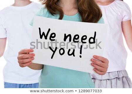 Közelkép lány tart szükség plakát lányok Stock fotó © AndreyPopov