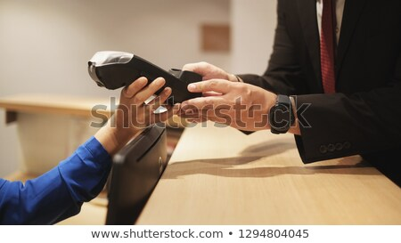 Hotel Guest Paying Business Travel With Credit Card and POS Stock photo © diego_cervo