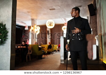 Immagine imprenditore 30s nero giacca guardando Foto d'archivio © deandrobot