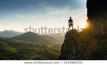 силуэта пеший турист человека сидят закат Сток-фото © nito