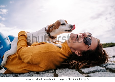 woman with terrier dog outside at the park Stock photo © Lopolo