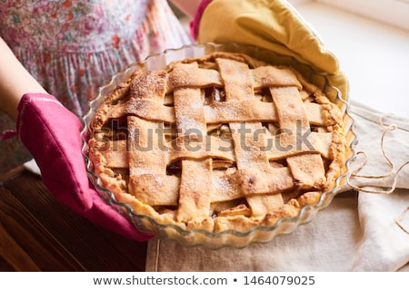 Foto stock: Female hand holding apple pie