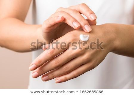 Handen jonge vrouw witte nagels manicure Stockfoto © Kzenon