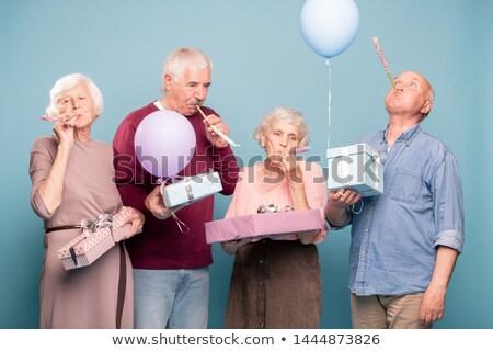 Dois senior casais aniversário diversão Foto stock © pressmaster
