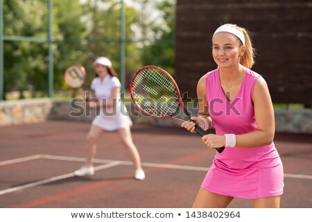 Young smiling woman in sports dress during outdoor game Stock photo © pressmaster