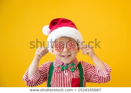 Cute kid dressed as santa Stock photo © nyul