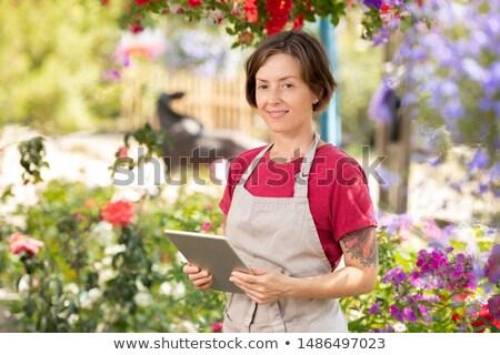 Heureux Homme jardinier touchpad travail ligne Photo stock © pressmaster