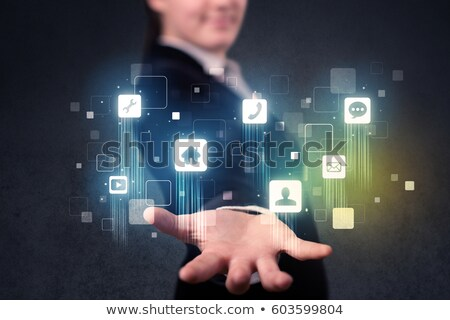 businesswoman hand with blue application icons. Technological background Stock photo © wavebreak_media