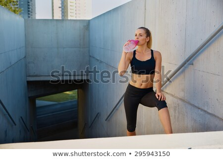 pretty young female runner resting on stairs stock photo © boggy
