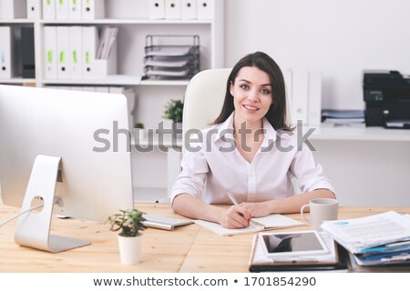 Young elegant businesswoman in formalwear looking at you Stock photo © pressmaster