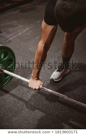 Man gymnasium triceps barbell sport Stockfoto © Jasminko