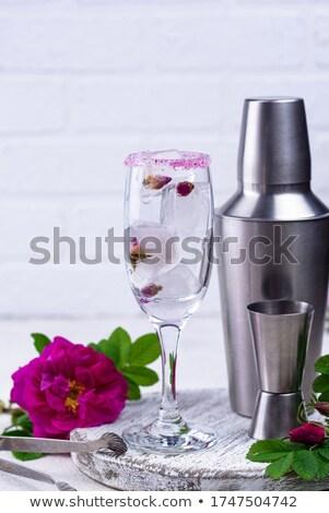 Jégkocka rózsabimbó pezsgő üveg folyamat virág Stock fotó © furmanphoto
