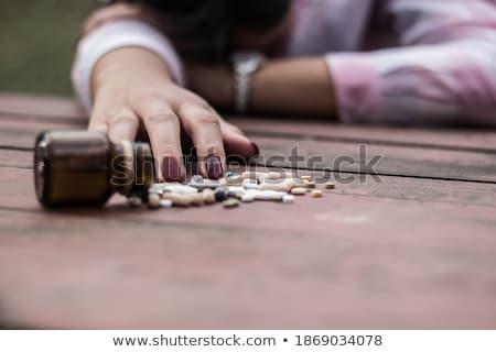 Problem teenager girl takes overdose of pills Stock photo © darrinhenry