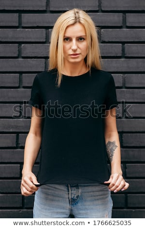 gyönyörű · szőke · nő · fekete · ruházat · vonzó - stock fotó © fotoduki