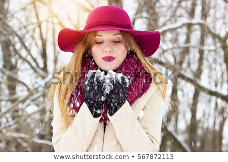 Winter Girl Blowing Into Cupped Hands Stock photo © stryjek