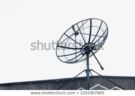 Large Satellite Dish on Roof, Blue Sky Background Stock photo © Qingwa