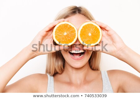 Hiding her eyes with oranges Stock photo © photography33