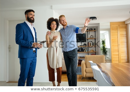 Three young men moving into to new house Stock photo © photography33