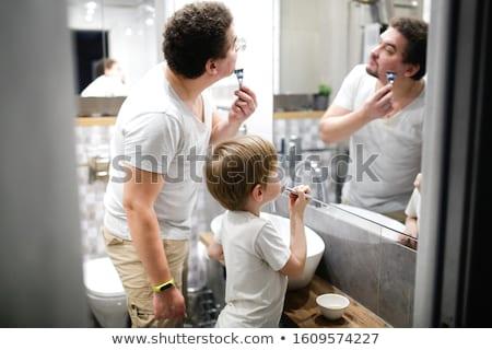 Fiatal férfiak fürdőszoba család haj egészség barátok Stock fotó © photography33