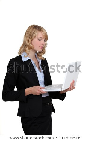 blond woman stood working on laptop computer stock photo © photography33