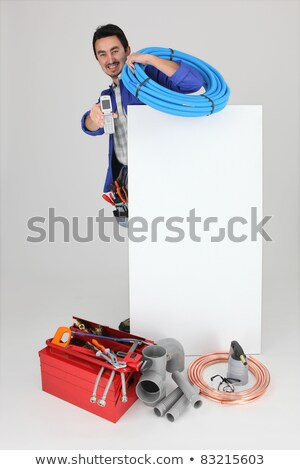 plumber with a cellphone a board left blank for your image stock photo © photography33