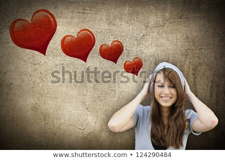 Beautiful brunette woman against grafitti wall  Stock photo © Fernando_Cortes