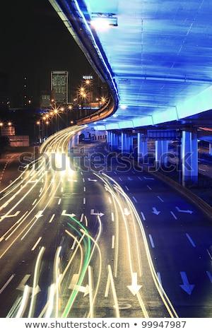 circular viaduct road rainbow light trails night scene stock photo © artphoto