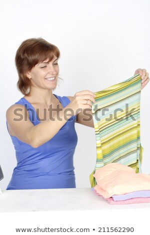 woman holding flatiron Stock photo © smithore