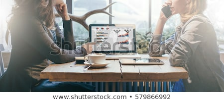 Young business woman showing tablet screen stock photo © dash