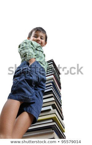 image of a schoolboy in front of a big stack of books stock photo © zurijeta