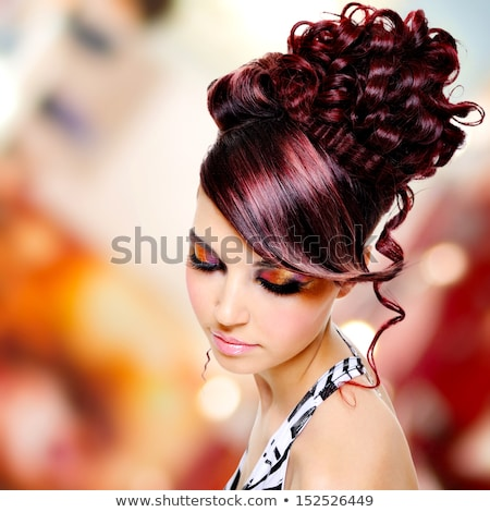 brunette with creative hairstyle on bokeh stock photo © carlodapino