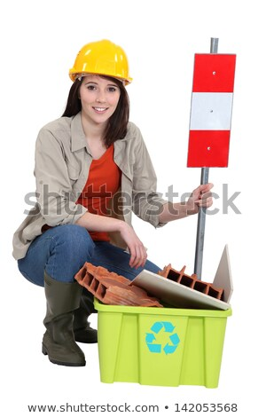 female builder kneeling by recycle box stock photo © photography33