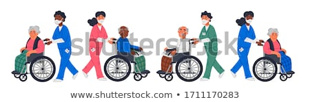 Nurse with patient in wheelchair Stock photo © UrchenkoJulia