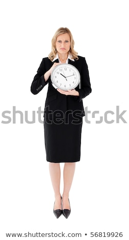 Glum businesswoman holding a clock against white background Stock photo © wavebreak_media