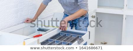 Handyman measuring something in a kitchen stock photo © wavebreak_media