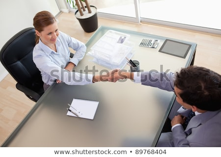 Above view of young consultant shaking hands with her client Stock photo © wavebreak_media