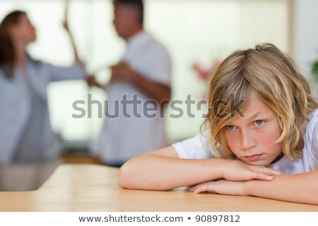 Worried looking boy with his fighting parents behind him stock photo © wavebreak_media