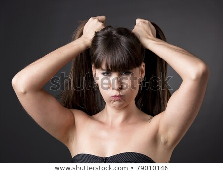 Woman pulls a face in upset grimace Stock photo © pzaxe