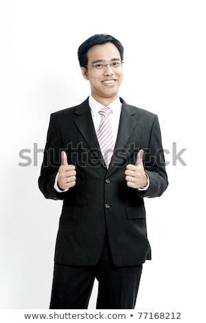 Portrait of a smiling businessman approving against white babckground Stock photo © wavebreak_media