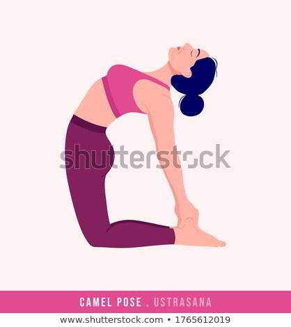 Smiling woman in camel yoga pose stock photo © wavebreak_media