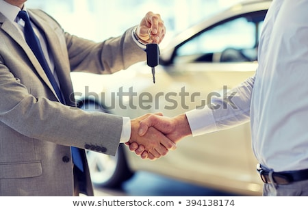 car seller gives keys to buyer stock photo © iqoncept