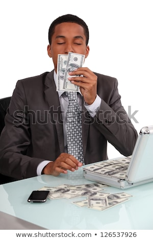 A con man smelling his loot Stock photo © photography33