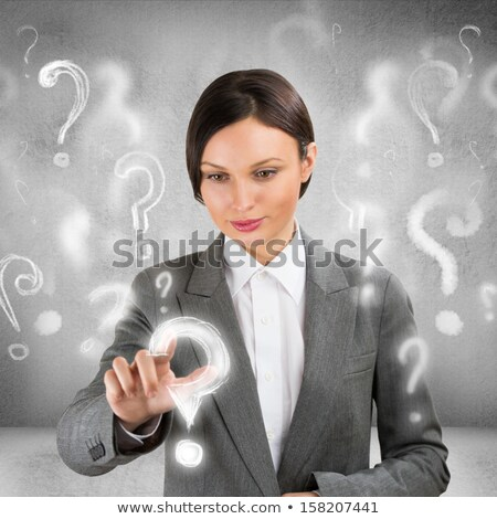 Business woman with question symbols around her. Choosing one an Stock photo © HASLOO
