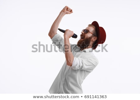 male hand with wireless microphone stock photo © simpson33
