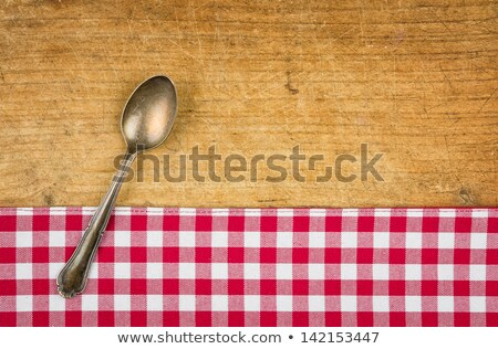 Silver Spoon On A Wooden Board With A Checkered Tablecloth Photo stock © Zerbor