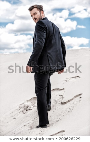 business man looks over his shoulder Stock photo © feedough