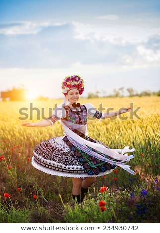 man wearing a folk ukrainian dress dancing Stock photo © stepstock
